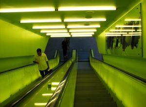 872473_man_on_neon_escalator.jpg
